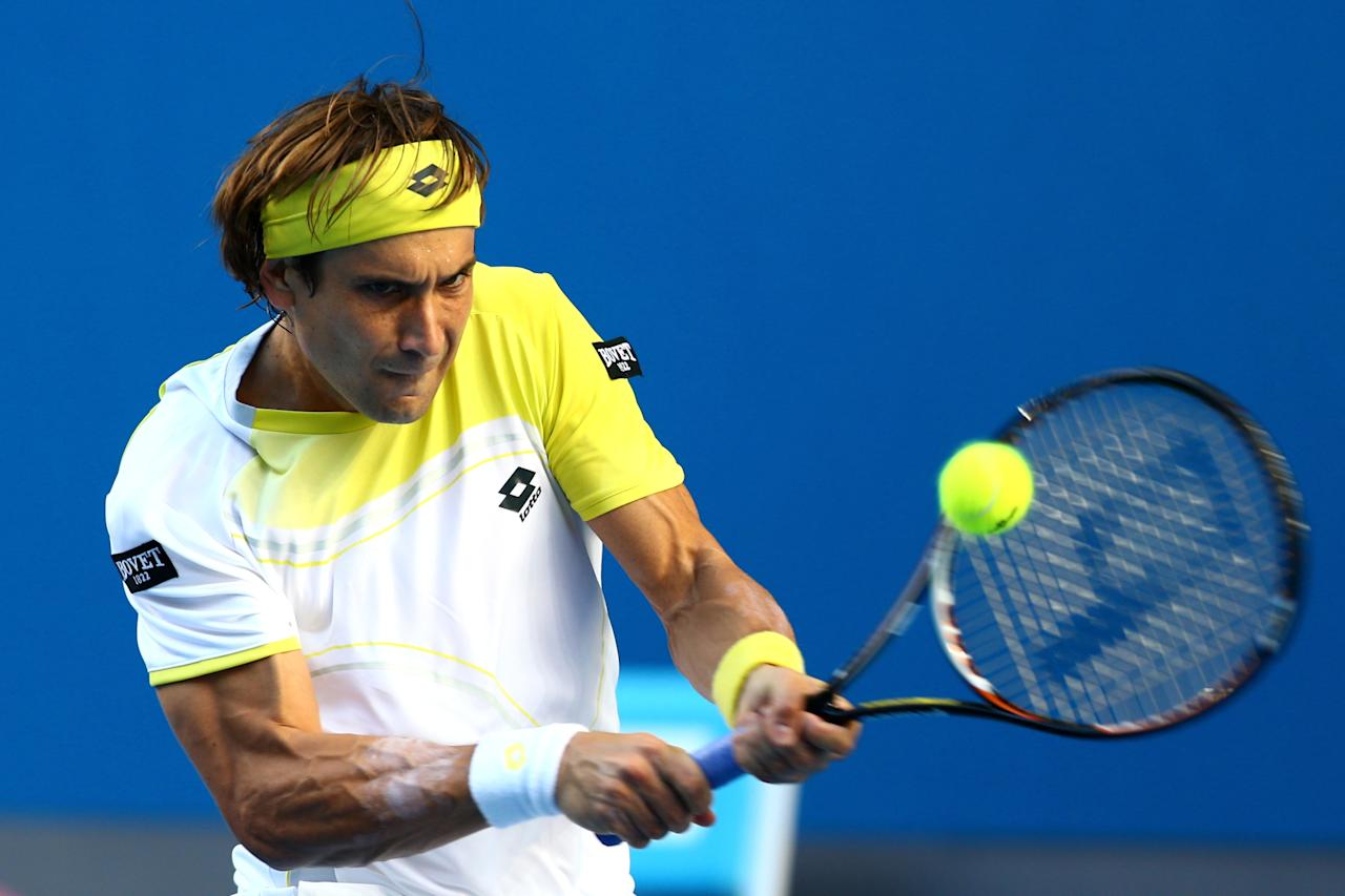 MELBOURNE, AUSTRALIA - JANUARY 14:  David Ferrer of Spain plays a backhand in his first round match against Olivier Rochus of Belgium during day one of the 2013 Australian Open at Melbourne Park on January 14, 2013 in Melbourne, Australia.  (Photo by Mark Kolbe/Getty Images)