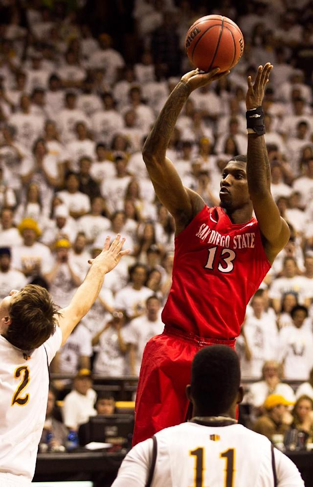 San Diego State forward Winston Shepard (13) pulls up for a jump shot during the first half against the University of Wyoming Cowboys in a NCAA college basketball game Tuesday, Feb. 11, 2014 at the Arena-Auditorium in Laramie, Wyo. (AP Photo/Jeremy Martin)