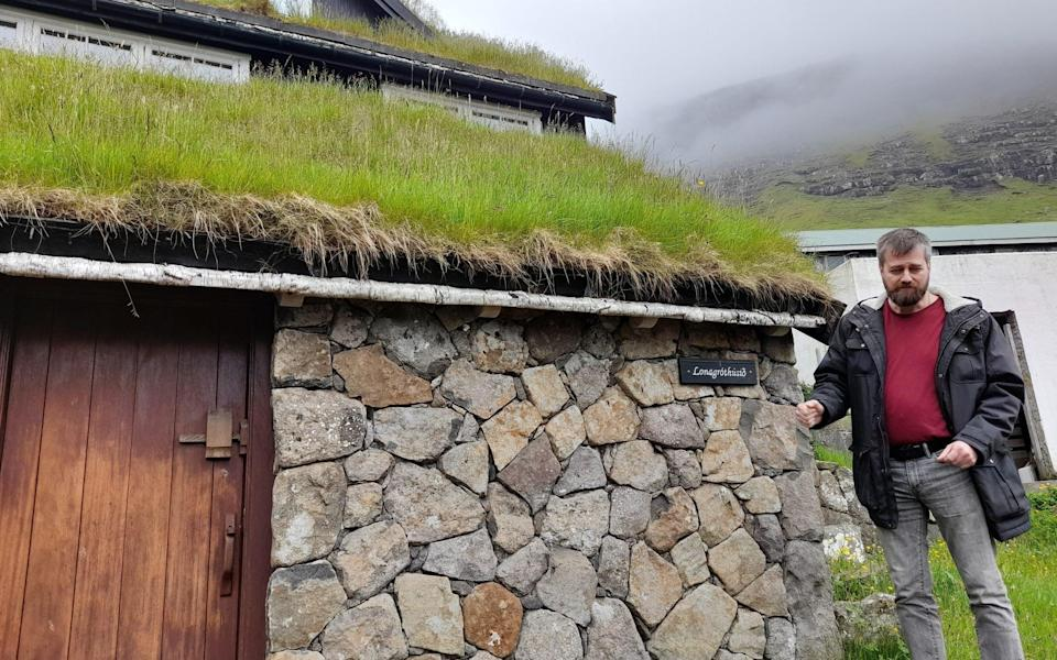 Guide shows a traditional croft house in Bøur - Mark Stratton