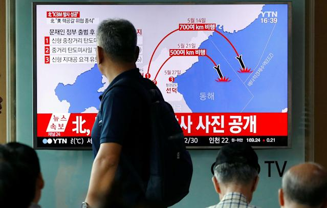 <p>A man walks past a TV broadcasting a news report on North Korea's the Hwasong-14 missile, a new intercontinental ballistic missile, which they said was successfully tested, at a railway station in Seoul, South Korea, July 4, 2017. (Photo: Kim Hong-Ji/Reuters) </p>