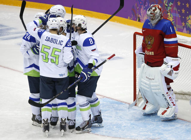 Russia goaltender Semyon Varlamov reacts as team Slovenia celebrates a second period goal during a men's ice hockey game at the 2014 Winter Olympics, Thursday, Feb. 13, 2014, in Sochi, Russia. (AP Photo/Mark Humphrey)