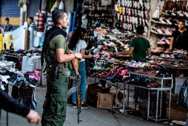 PHOTO: A member of the Kurdish Internal Security Police Force of Asayish stands guard at a market in the northeastern Syrian city of Qamishli on August 5, 2019. (Delil Souleiman/AFP/Getty Images)