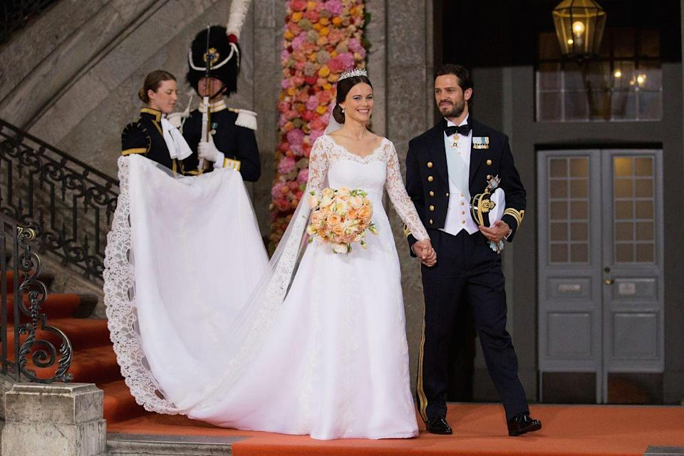 """<p>Princess Sofia's gown was created by Swedish designer <a href=""""https://www.theknot.com/content/princess-sofia-hellqvist-prince-carl-philip-wedding-dress"""" rel=""""nofollow noopener"""" target=""""_blank"""" data-ylk=""""slk:Ida Sjöstedt"""" class=""""link rapid-noclick-resp"""">Ida Sjöstedt</a> and featured long lace sleeves and a matching veil.</p>"""