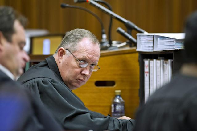 PRETORIA, SOUTH AFRICA - APRIL 11: (SOUTH AFRICA OUT): Advocate Kenny Oldewage in the Pretoria High Court on April 11, 2014, in Pretoria, South Africa. Oscar Pistorius stands accused of the murder of his girlfriend, Reeva Steenkamp, on February 14, 2014. This is Pistorius' official trial, the result of which will determine the paralympian athlete's fate. (Photo by Craig Nieuwenhuizen/Foto24/Gallo Images - Pool /Getty Images)