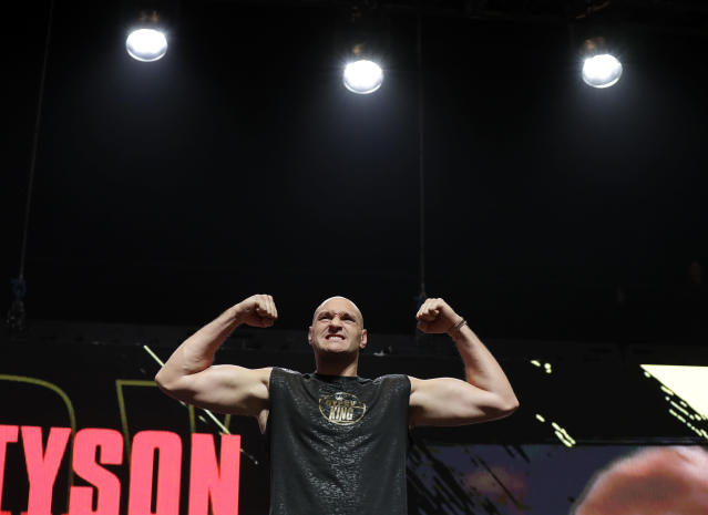 Tyson Fury, of England, stands on the scale during a weigh-in for his WBC heavyweight championship boxing match against Deontay Wilder, Friday, Feb. 21, 2020, in Las Vegas. (AP Photo/Isaac Brekken)