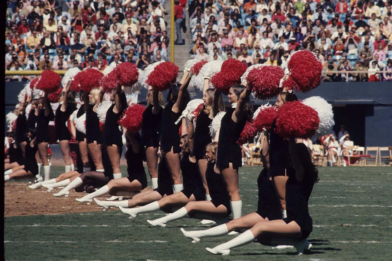 ATLANTA, GA - OCTOBER 8:  The Atlanta Falcons cheerleaders cheer on the the field during an NFL game against the Detroit Lions at Fulton-County Stadium on October 8, 1972 in Atlanta, Georgia. The Lions defeated the Falcons 26-23. (Photo by Bob Verlin/Getty Images)