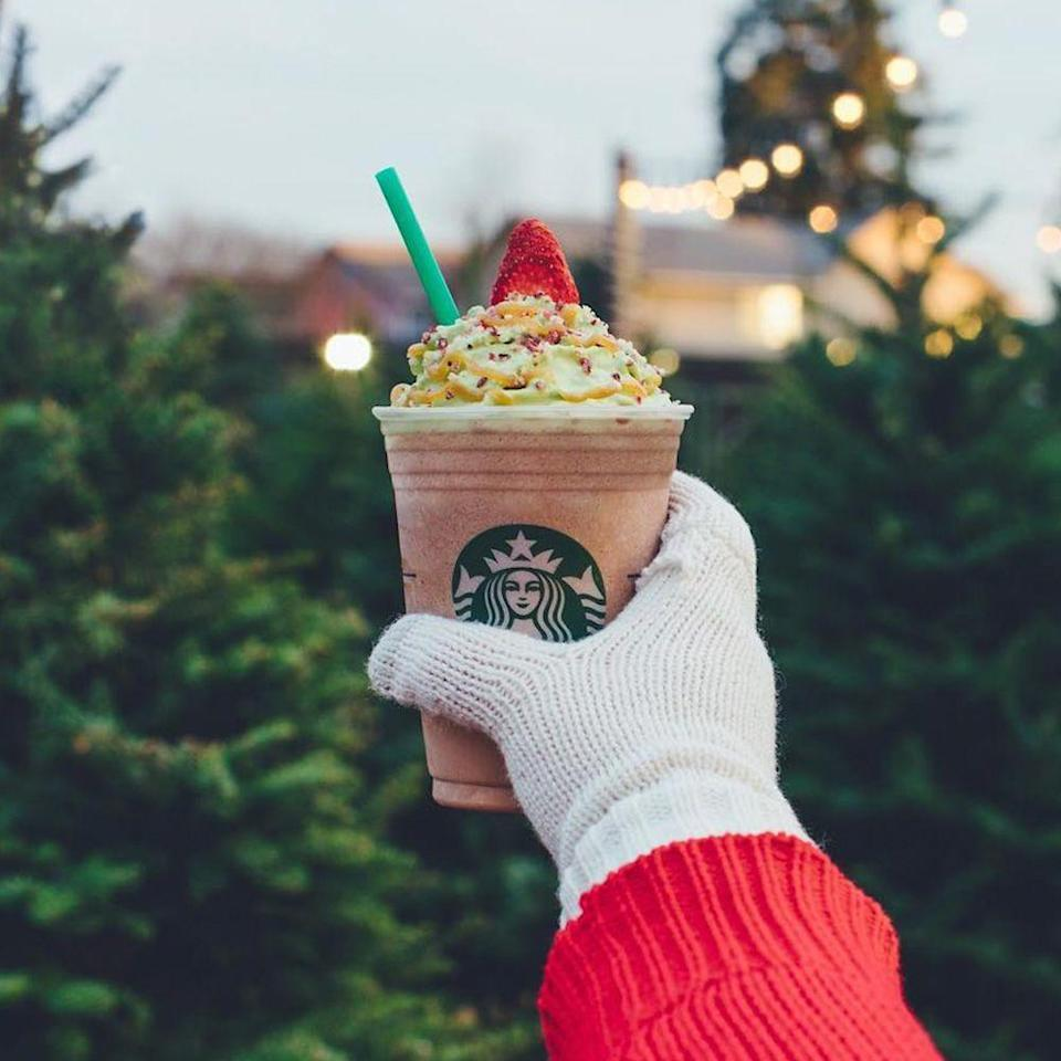 """<p>Christmastime is meant to involve festive treats, and this mocha and peppermint drink is fit for the occasion. The Christmas Tree Frappuccino is topped with matcha-infused whipped cream, caramel drizzle, candied cranberries, and a strawberry """"topper.""""</p>"""