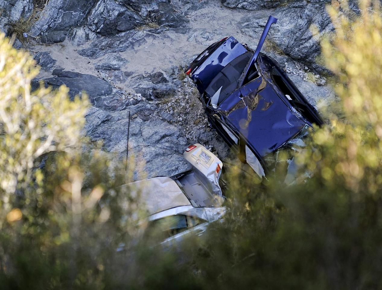 Two cars at the bottom of a remote mountain are recovered in Castaic, Calif., Friday, Sept. 30, 2011 . David Lavau, whose car had plunged 200 feet off a remote mountain road, was found yesterday by his three adult children, who had enlisted the help of a missing persons detective. Lavau suffered multiple rib fractures, a broken arm and multiple fractures in his back. While he was being rescued, another vehicle was found nearby, its driver dead. Authorities don't know if that vehicle was involved in a collision with Lavau's car, or if it was a separate accident. (Photo/Gus Ruelas)