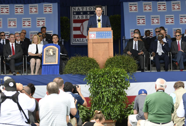 National Baseball Hall of Fame inductee Mike Mussina, former Baltimore Orioles and New York Yankees pitcher speaks during an induction ceremony at the Clark Sports Center on Sunday, July 21, 2019, in Cooperstown, N.Y. (AP Photo/Hans Pennink)