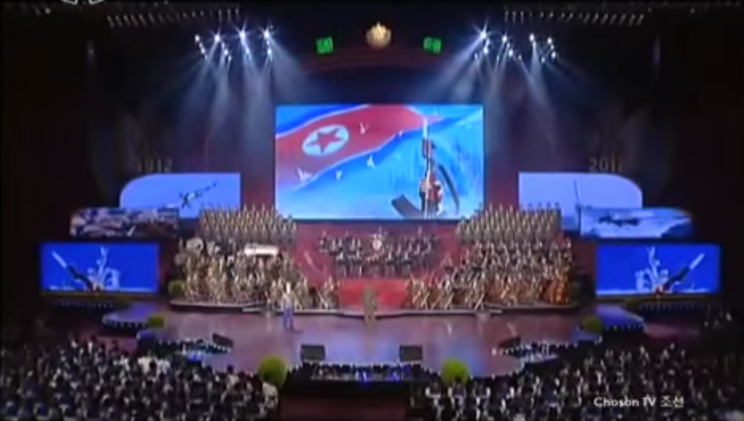 Footage has emerged of a rousing classical concert in North Korea featuring images that appear to show a nuclear bomb being dropped on America.