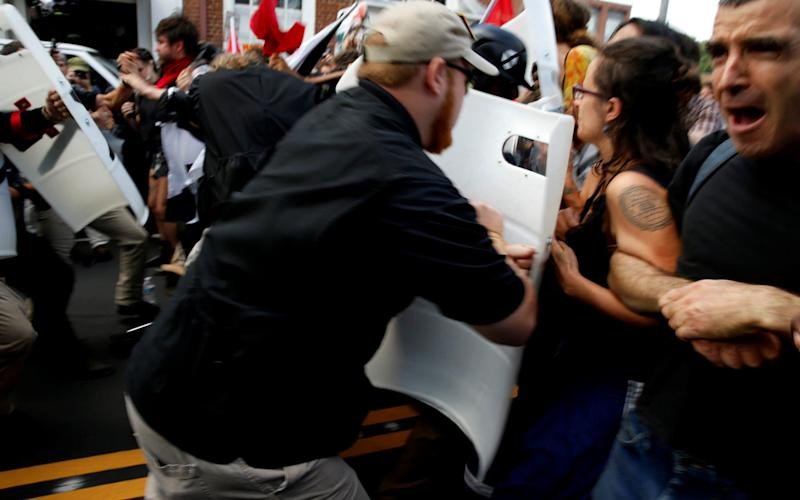 White supremacists clash with counter protesters in Charlottesville - REUTERS