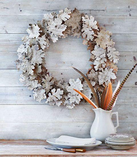 "<p>Use birch bark sheets to craft a handful of leaves that can be turned into a frosted, seasonal wreath.</p><p>See more at <a href=""http://www.countryliving.com/diy-crafts/how-to/g1056/diy-wreath-ideas/?slide=6"" rel=""nofollow noopener"" target=""_blank"" data-ylk=""slk:Country Living"" class=""link rapid-noclick-resp"">Country Living</a>. </p>"