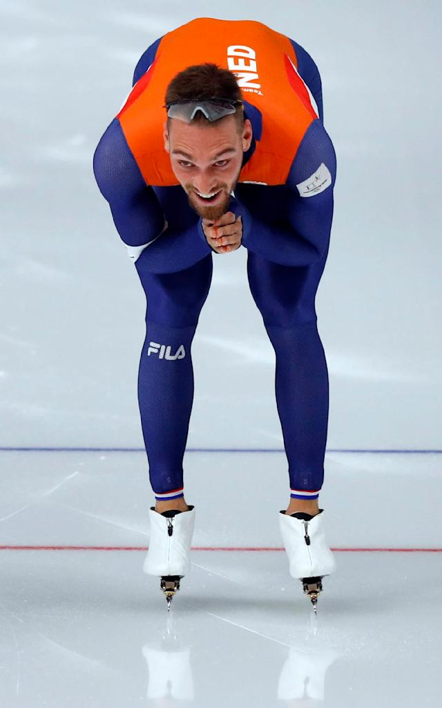 Speed Skating - Pyeongchang 2018 Winter Olympics - Men's 1000m competition finals - Gangneung Oval - Gangneung, South Korea - February 23, 2018 - Kjeld Nuis of the Netherlands celebrates after winning a gold medal. REUTERS/Phil Noble