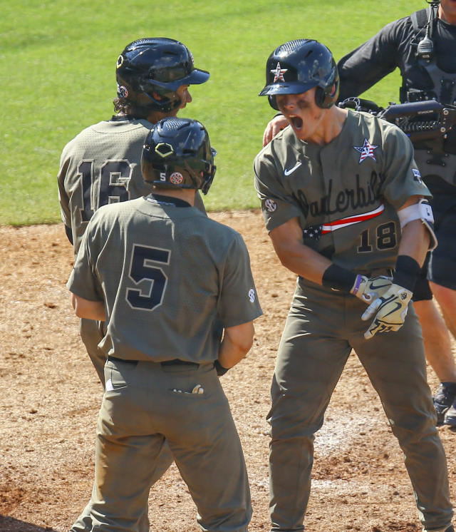 Vanderbilt's Pat DeMarco (18) celebrates with Austin Martin (16) and Philip Clarke (5) after hitting a three-run home run during the fifth inning of the Southeastern Conference tournament NCAA college baseball championship game against Mississippi, Sunday, May 26, 2019, in Hoover, Ala. (AP Photo/Butch Dill)