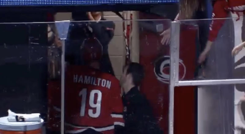 Carolina's Dougie Hamilton gives Patrick Budds a nut tap following the Hurricanes' 4-3 overtime win against the Tampa Bay Lightning on Sunday night.