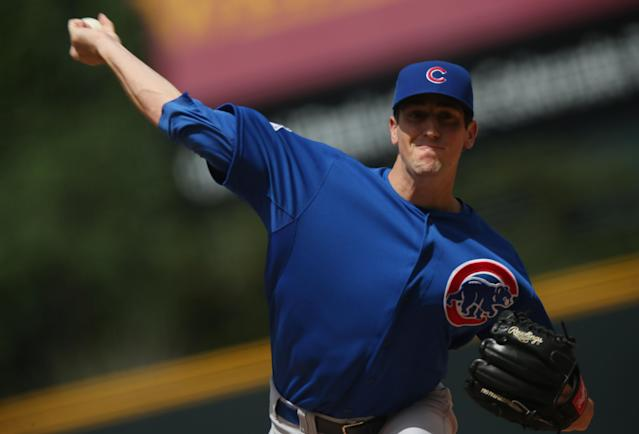Chicago Cubs starting pitcher Kyle Hendricks works against the Colorado Rockies in the first inning of a baseball game in Denver on Thursday, Aug. 7, 2014. (AP Photo/David Zalubowski)
