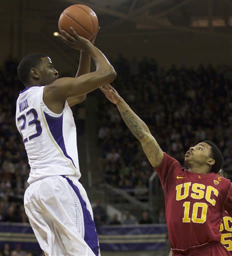 University of Washington's C.J. Wilcox, left, shoots over Maurice Jones of USC during play in a Pac-12 game at Alaska Airlines Arena in Seattle Saturday Feb. 4, 2012