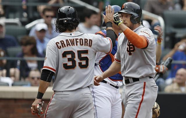 San Francisco Giants' Brandon Crawford (35) greets Giants' Hunter Pence at the plate after scoring on Pence's third-inning, two-run home run in a baseball game in New York, Sunday, Aug. 3, 2014. (AP Photo/Kathy Willens)
