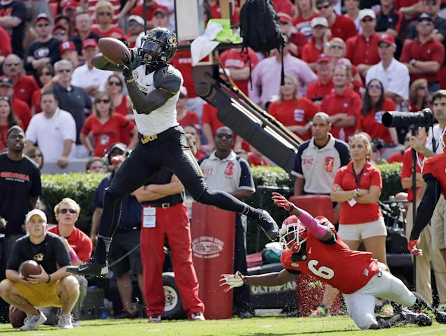 Missouri's Dorial Green-Beckham,l eft, makes a catch as Georgia's Shaq Williams defends during the second half of an NCAA college football game Saturday, Oct. 12, 2013, in Athens, Ga. Missouri won 41-26. (AP Photo/John Bazemore)