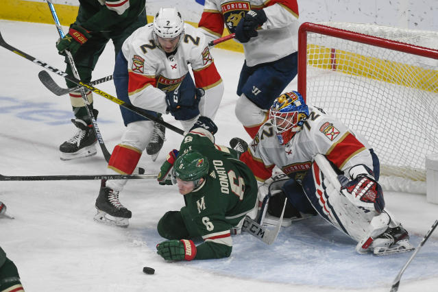 Florida Panthers defenseman Josh Brown (2) collided with Minnesota Wild center Ryan Donato in front of Panthers goalie Sergei Bobrovskyduring the first period of an NHL hockey game Monday, Jan. 20, 2020, in St. Paul, Minn. (AP Photo/Craig Lassig)