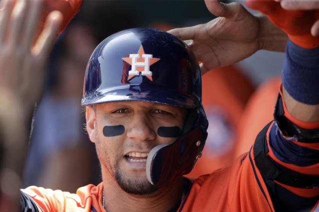 Houston Astros' Yuli Gurriel celebrates in the dugout after hitting a solo home run during the second inning of a baseball game against the Kansas City Royals, Sunday, Sept. 15, 2019, in Kansas City, Mo. (AP Photo/Charlie Riedel)