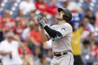 Miami Marlins' Adam Duvall gestures as he approaches home plate after hitting a home run during the third inning of a baseball game against the Philadelphia Phillies, Sunday, July 18, 2021, in Philadelphia. (AP Photo/Laurence Kesterson)