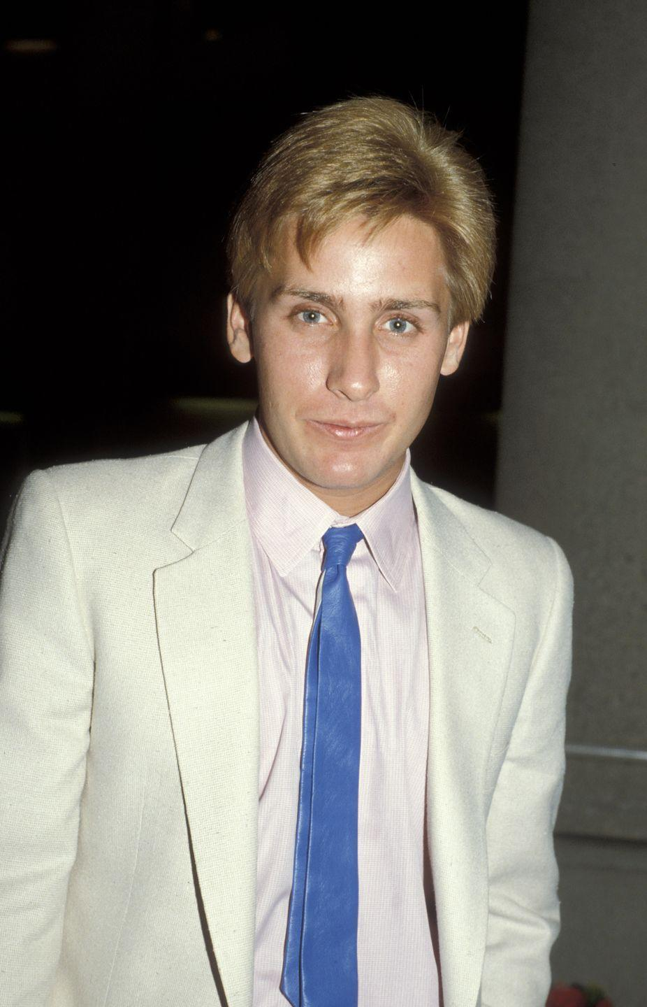 "<p>Emilio Estevez is best known as being an original member of the <a href=""https://www.imdb.com/name/nm0000389/"" rel=""nofollow noopener"" target=""_blank"" data-ylk=""slk:&quot;Brat Pack,&quot;"" class=""link rapid-noclick-resp"">""Brat Pack,""</a> after appearing in some of the most iconic movies from the '80s, including <em>The Breakfast Club </em>(1985), <em>St. Elmo's Fire </em>(1985), and <em>The Outsiders </em>(1983)<em>.</em></p>"