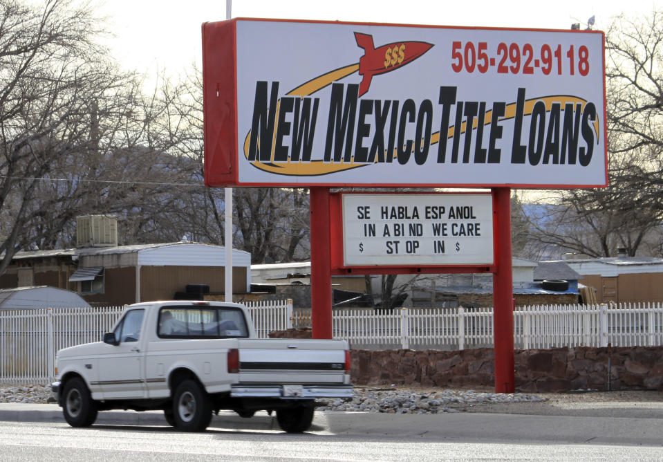 A truck heads east along historic Route 66, past one of the approximately 700 small lenders operating in New Mexico, in Albuquerque, New Mexico on Friday, February 3, 2017. Two lawmakers of New Mexico introduced new legislation targeting salary and title again.  the lending industry, seeking to cap interest rates at 36%.  (AP Photo / Susan Montoya Bryan)