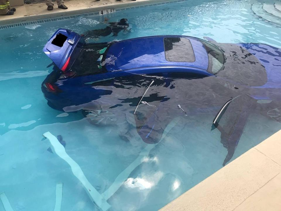 <em>Carpool – the car ended up rolling into the pool when a woman thought she had put it into park but hadn't (Pictures: SWNS)</em>