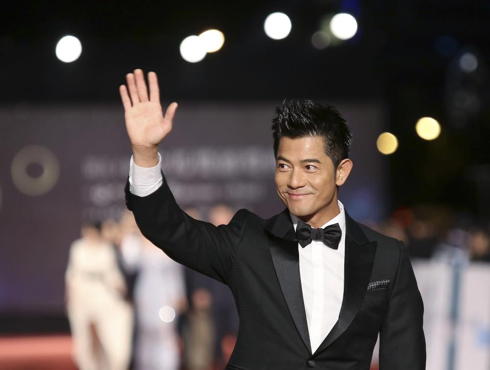 Hong Kong singer and actor Aaron Kwok poses for photographers on the red carpet at the 50th Golden Horse Film Awards in Taipei November 23, 2013. REUTERS/Patrick Lin (TAIWAN - Tags: ENTERTAINMENT)