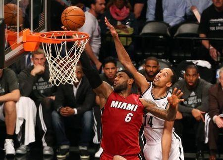 Miami Heat forward LeBron James (6) puts up a shot in front of Brooklyn Nets guard Shaun Livingston (14) during the third quarter in game four of the second round of the 2014 NBA Playoffs at Barclays Center. Miami Heat won 102-96. Anthony Gruppuso-USA TODAY Sports