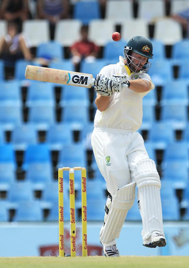 Australia's batsman Alex Doolan, takes evasive action against a bouncer on the third day of their their cricket test match against South Africa at Centurion Park in Pretoria, South Africa, Friday, Feb. 14, 2014. (AP Photo/ Themba Hadebe)