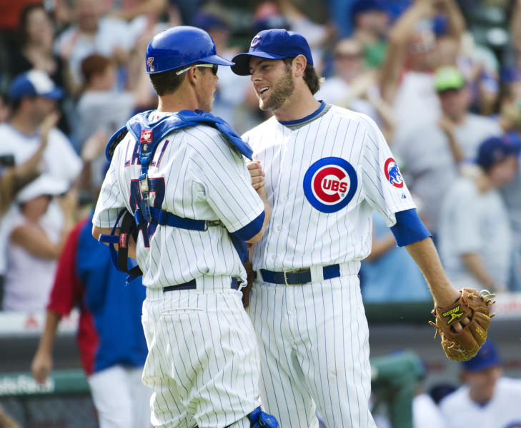 Chicago Cubs catcher Blake Lalli, left, and relief pitcher Casey Coleman celebrate their 11-7 win over the San Diego Padres after a baseball game, Monday, May 28, 2012, in Chicago. (AP Photo/Brian Kersey)