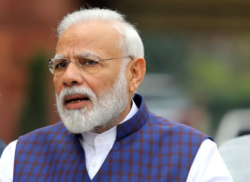 India's PM Modi speaks to the media inside the parliament premises on the first day of the winter session in New Delhi