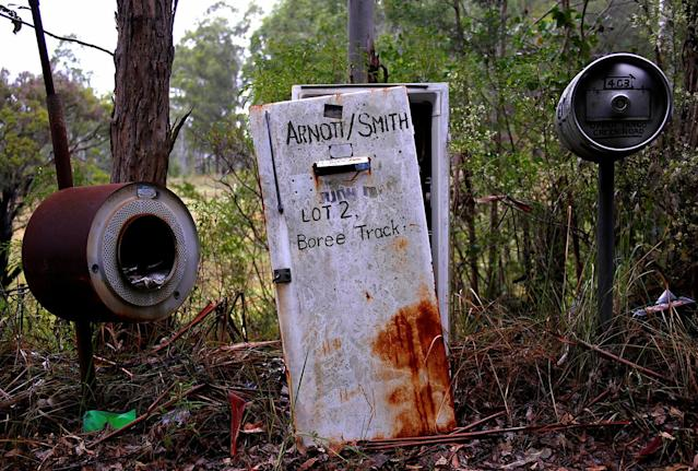 <p>An old refrigerator, an old washing machine, and a beer keg serve as mailboxes in the outskirts of Wollombi township, north of Sydney, Australia. (Photo: David Gray/Reuters) </p>