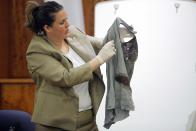 Massachusetts State Police Trooper, Heather Sullivan, holds up clothing from the body of Odin Lloyd, as evidence in the murder trial of former New England Patriots tight end, Aaron Hernandez, at Bristol County Superior Court in Fall River, Massachusetts, February 24, 2015. Hernandez is accused of the murder of Odin Lloyd in June 2013. REUTERS/Brian Snyder (UNITED STATES - Tags: CRIME LAW SPORT FOOTBALL)