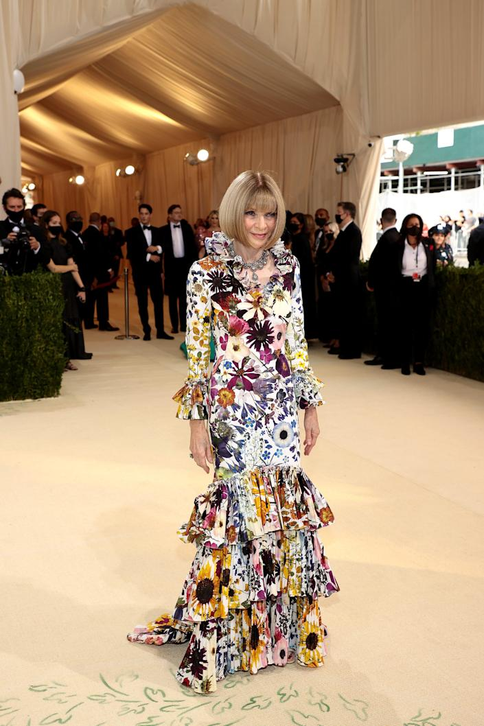 Anna Wintour wears a floral dress on the 2021 Met Gala red carpet.