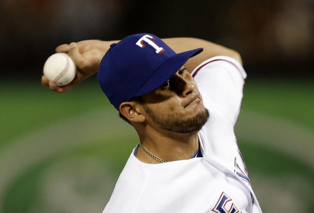 Texas Rangers starting pitcher Martin Perez delivers to the Philadelphia Phillies in the fifth inning of a baseball game, Tuesday, April 1, 2014, in Arlington, Texas. (AP Photo/Tony Gutierrez)