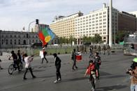 Demonstrators rally outside the government palace to protest against Chile's state economic model, in Santiago