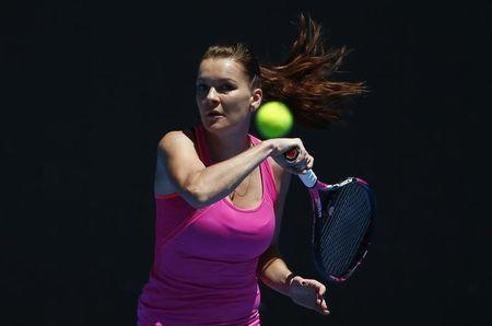 Poland's Agnieszka Radwanska hits a shot during a training session ahead of the Australian Open tennis tournament in Melbourne, Australia, January 15, 2017. REUTERS/Edgar Su
