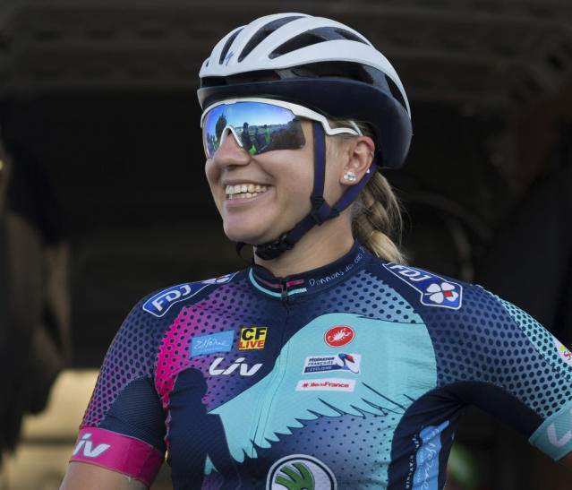 Tetiana Kalachova, a member of female team of amateur cyclists which is completing the Tour de France route to promote the return of the women's Tour, smiles as she poses for a picture in Carcassonne, France, Monday July 23, 2018. (AP Photo/Ciaran Fahey)