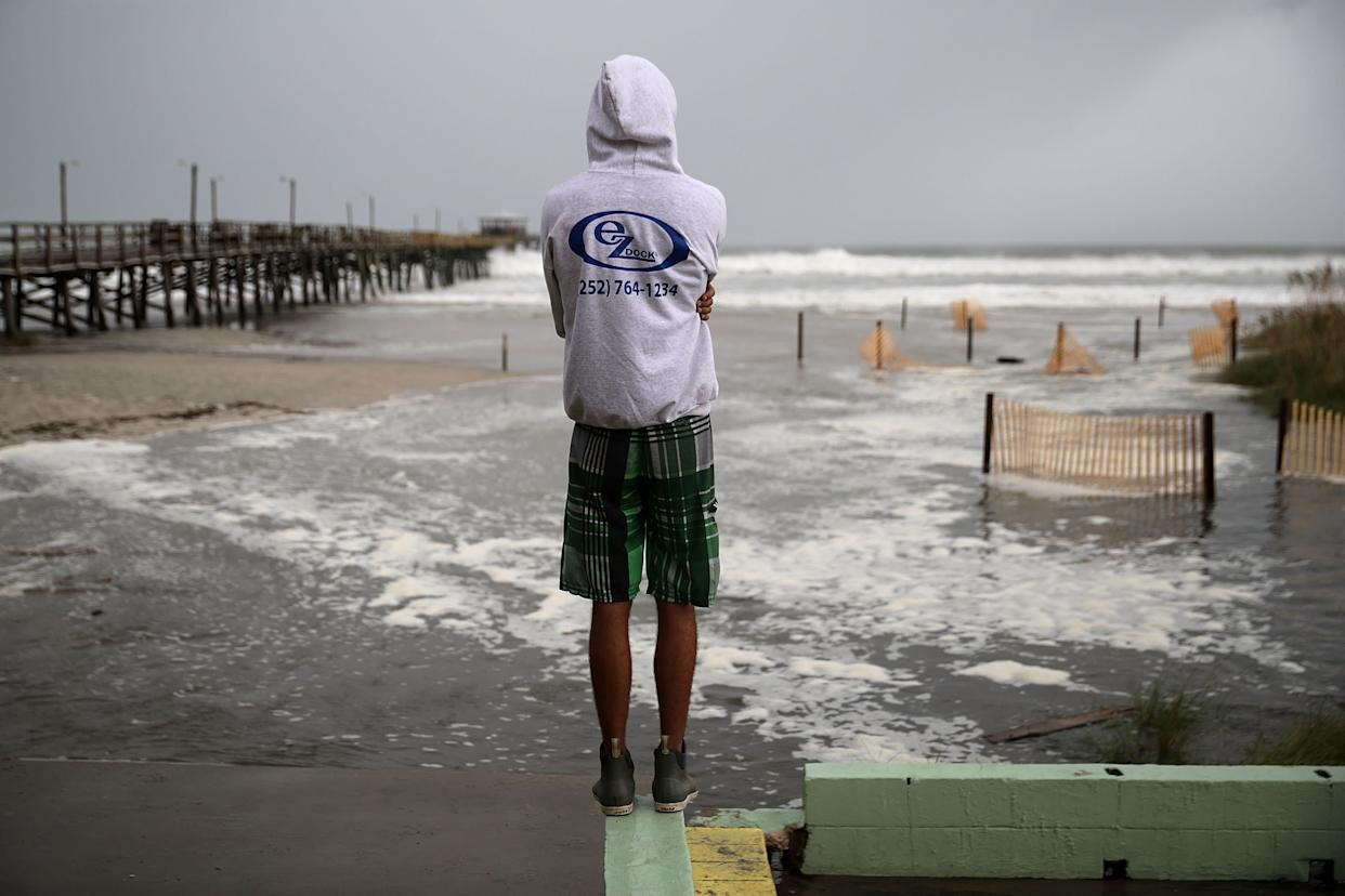 Water rolls up Atlantic Beach as the outer edges of Hurricane Florence beginto affect the coast on Thursday.