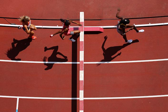 <p>Peruth Chemutai (R) of Team Uganda competes in round one of the Women's 3000m Steeplechase heats on day nine of the Tokyo 2020 Olympic Games at Olympic Stadium on August 01, 2021 in Tokyo, Japan. (Photo by Richard Heathcote/Getty Images)</p>