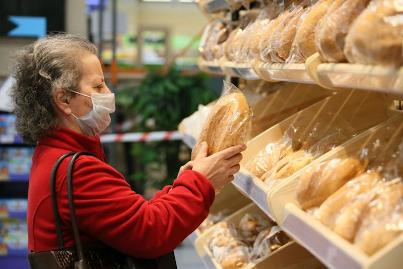 A customer shops for bread in a supermarket: Source: Getty