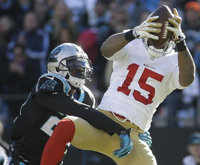 San Francisco 49ers wide receiver Michael Crabtree (15) makes a catch against Carolina Panthers cornerback Melvin White (23) during the first half of a divisional playoff NFL football game, Sunday, Jan. 12, 2014, in Charlotte, N.C. (AP Photo/John Bazemore)