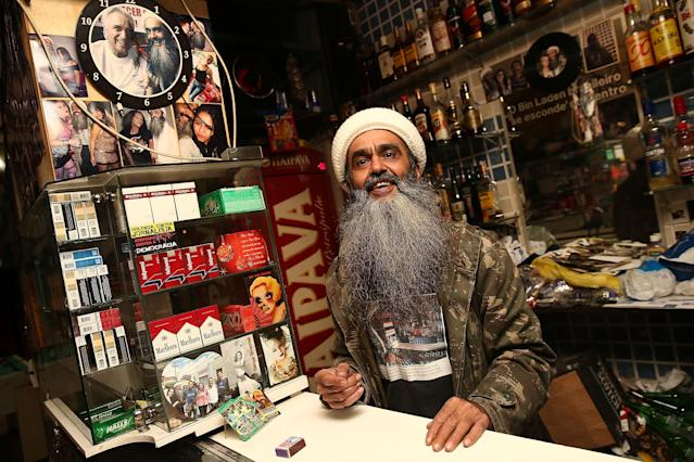 SAO PAULO, BRAZIL - APRIL 29: Osama bin Laden lookalike Ceara Francisco Helder Braga Fernandes poses in his 'Bar do Bin Laden' on April 29, 2014 in Sao Paulo, Brazil. Braga says he was known as the 'Beard Man' before 9/11 but became known as a Bin Laden lookalike following the 9/11 attacks. He says he is Christian and continues to play the role to support his business. (Photo by Mario Tama/Getty Images)