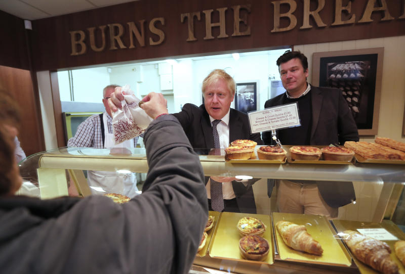 Britain's Prime Minister Boris Johnson visits a bakery during a General Election campaign trail stop in Wells, England, Thursday, Nov. 14, 2019. Britain goes to the polls on Dec. 12. (AP Photo/Frank Augstein, Pool)