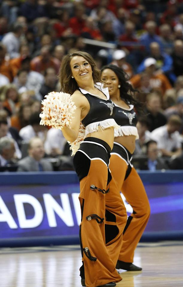 Texas cheerleaders perform during the first half of a second-round game between the Texas and the Arizona State in the NCAA college basketball tournament Thursday, March 20, 2014, in Milwaukee. (AP Photo/Jeffrey Phelps)