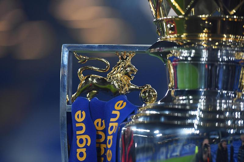 The prize: Team are fighting for the right to lift the Premier League trophy