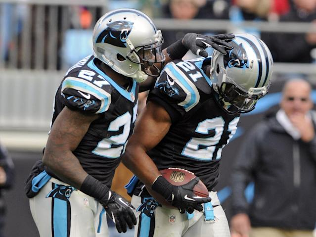 Carolina Panthers' Mike Mitchell (21) is congratulated by Quintin Mikell (27) after an interception against the Tampa Bay Buccaneers in the second half of an NFL football game in Charlotte, N.C., Sunday, Dec. 1, 2013. (AP Photo/Mike McCarn)